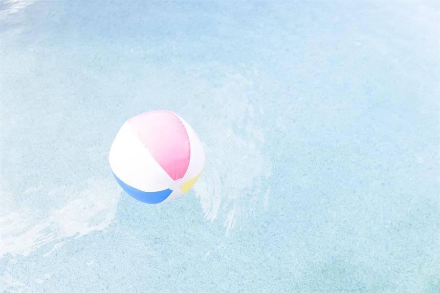 Beach ball in a swimming pool