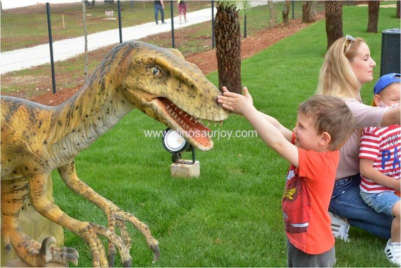Child playing with the dinosaur head